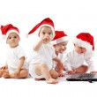 Christmas babies with laptop — Stock Photo #3944836