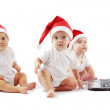 Christmas babies with laptop — Stock Photo