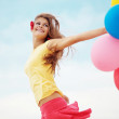 Girl with balloons — Stock Photo #3978273