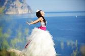 Bride over sea landscape — Stock Photo
