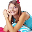 Girl restion on pillows - Stockfoto