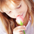 Child holding rose — Stock Photo #4175913