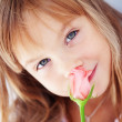 Child holding rose — Stock Photo #4175917