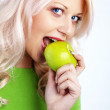 Woman holding green apple — Stockfoto #4199476