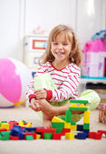Child playing with bricks — Stock Photo