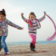 Kids playing at the beach — Stock Photo #4213293