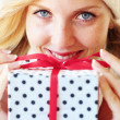 Woman holding gift - Stock Photo
