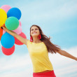 Girl with balloons — Stock Photo #4222914