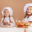 Little cute bakers — Stock Photo
