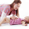 Stock Photo: Mother playing with her daughter