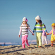 Kids playing at the beach — Stock Photo #4222979