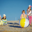 Foto de Stock  : Kids playing at the beach