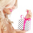 Young woman holding gift — Stock Photo