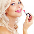 Applying lipstick — Stock Photo