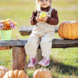 Foto Stock: Child with pumpkins