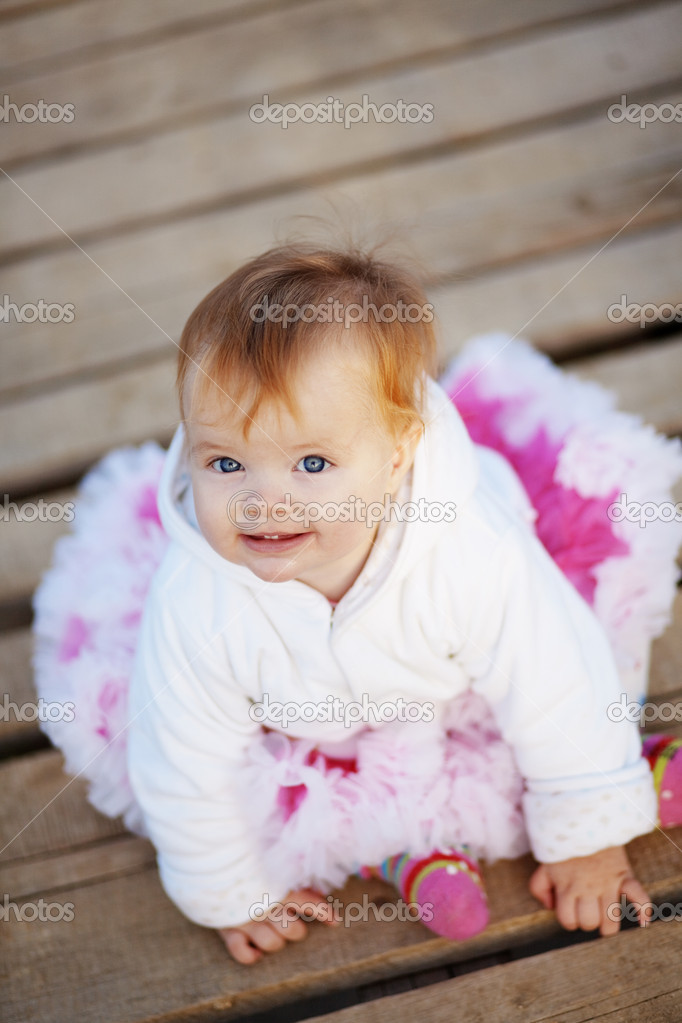Adorable baby on wooden bridge — Stock Photo #4291980