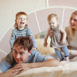 Happy family at home — ストック写真