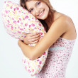Girl holding pillow — Stock Photo