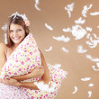 Girl holding pillow - Foto Stock