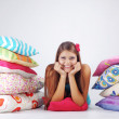Girl restion on pillows — Stock Photo