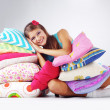 Girl restion on pillows — Stock Photo #4339045
