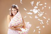 Girl holding pillow — Stock Photo