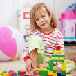Child playing with bricks - Stock Photo