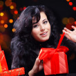 Royalty-Free Stock Photo: Cute woman with presents at night