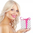 Young woman holding gift — Stock Photo #4732632