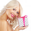 Young woman holding gift — Stock Photo #4732636
