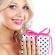 Young woman holding gift - Stock Photo