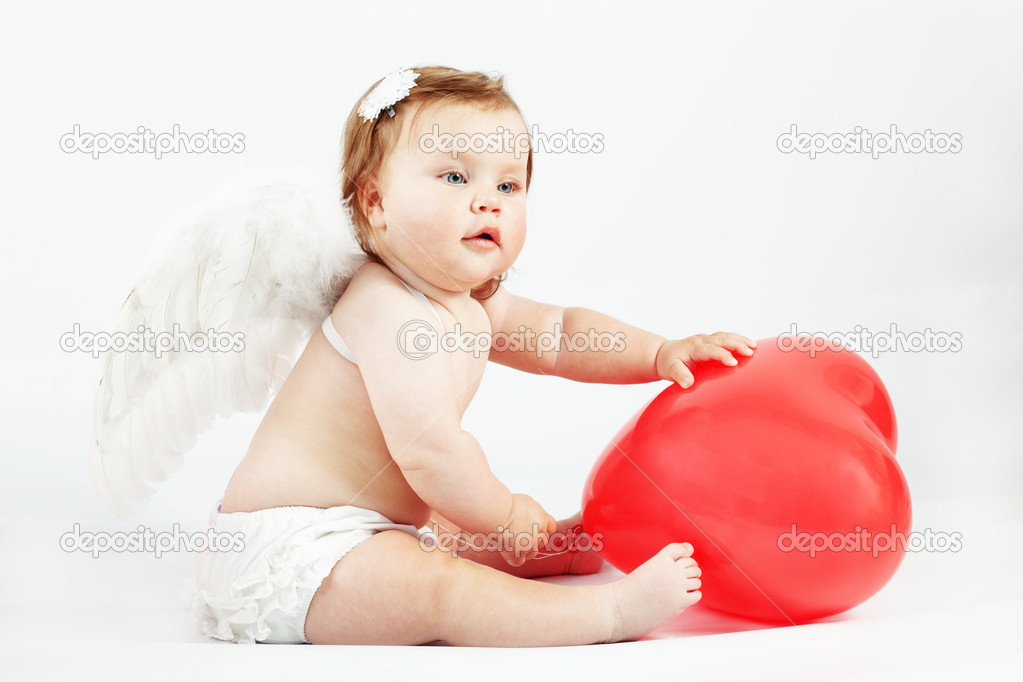 Cute valentine angel baby with red heart on light studio background — Stock Photo #4732555