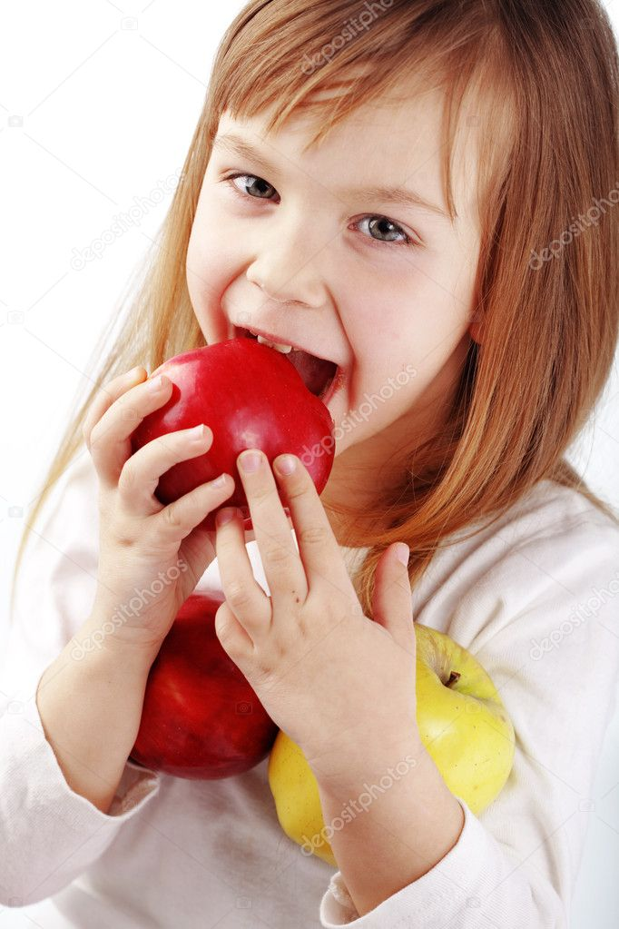 Cute kid girl eating apples over white — Stock Photo #5060029