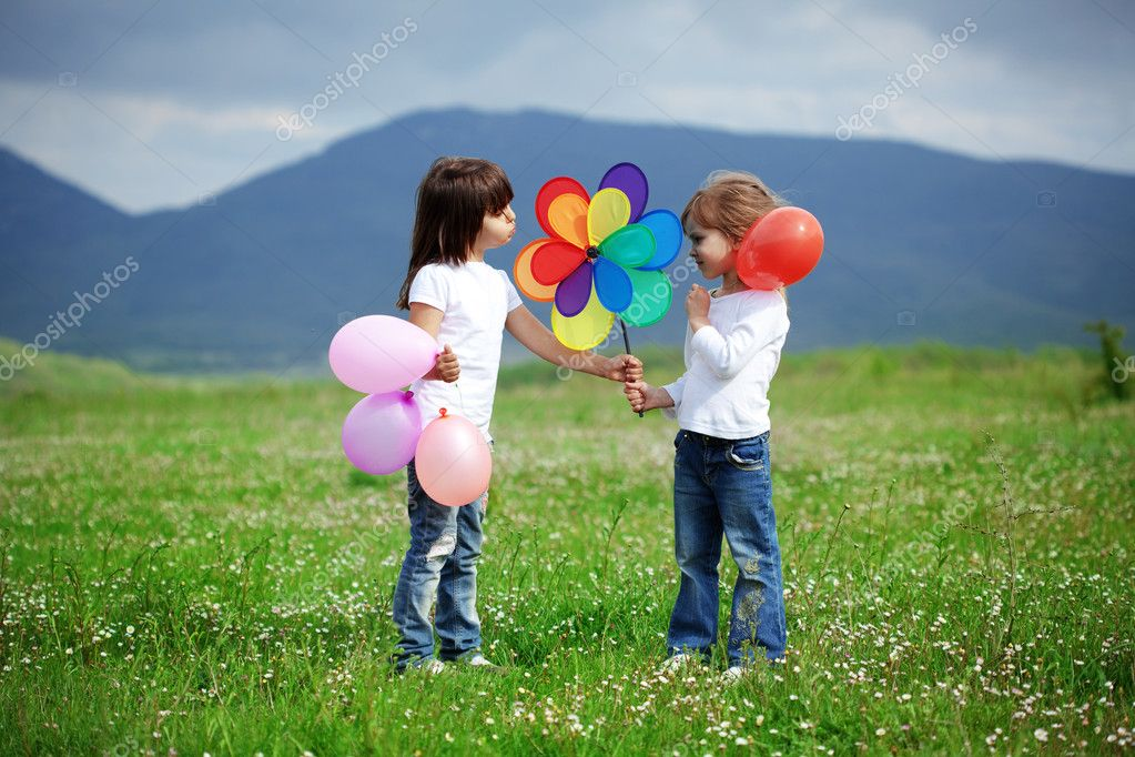 Cute happy children playing in spring filed — Stock Photo #5060384