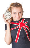 Girl in jean dress with alarm clock. Isolated in white — Stock Photo