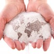 Sand with map of the world in the hands — Stock Photo
