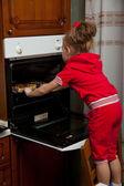 A little girl is cooking — Stok fotoğraf