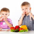 Boys and plates of vegetables and meat — Stock Photo #5324749