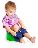 Chłopiec siedzi na pot — Zdjęcie stockowe