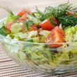 Fresh vegetable salad with tomato, lettuce, cucumber  Fresh vegetable salad - Stock Photo