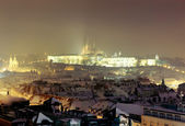Prague Castle at twilight in haze — Stock Photo