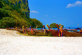 Longtailboats tied up at a beach in Krabi — Stock Photo