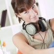 Woman relaxing with earphones on home — Stock Photo