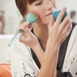 Woman applying make up — Foto Stock