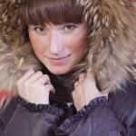 Woman in fur hood — Stock Photo