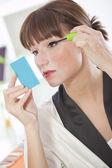 Woman making eye make up — Stock Photo