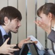 Stock Photo: Two office workers in conflict