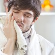 Man with toothache at home — Stock Photo #4289499