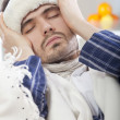 Sick man with high fever - Stock Photo