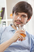 Man with glass juice — Stock Photo